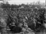 The audience attending an evening performance of the 'Kiwis' during World War I, Louvencourt