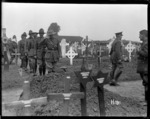 Officers saluting the grave of Brigadier General Johnston killed in 1917