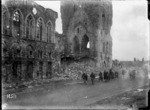 New Zealand soldiers passing the ruins of the Cloth Hall in Ypres, Belgium