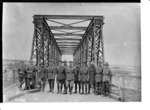 New Zealand engineers with the iron bridge that they designed and built