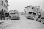 New Zealand Bren carriers at the captured village of Sesto Imolese, Italy - Photograph taken by George Kaye