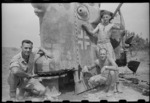 New Zealanders by a recaptured New Zealand Sherman tank, World War II, Italy - Photograph taken by George Kaye