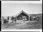 Maori tangi at meeting house, (Ruatapu, West Coast?) - Photographer possibly Alfred Burton
