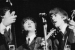 Beatles Paul McCartney, John Lennon and George Harrison singing during their Wellington concert