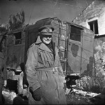 Bernard Cyril Freyberg standing beside truck
