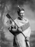Unidentified Maori chief holding a tewhatewha