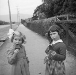 Two girls holding ice creams