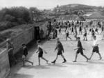 Devonport school pupils entering air raid shelters