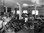 Civilian women inside a supply depot during World War I