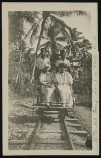 Mrs. Goward going for joy ride on a light rail dolly, Ocean Island, Kiribati, 1900-1917