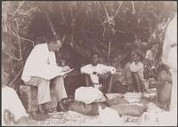 Dr. Welchman distributing teachers pay at Maewo, New Hebrides, 1906 / J.W. Beattie