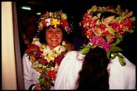 Women wearing 'ei upoko (head wreaths), Cook Islands