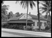 Unidentified RNZAF men outside the Hotel Rarotongan [or Rarotonga?], Rarotonga, Cook Islands