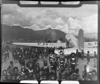 Qantas Empire Airways aircraft VH-EAP, on airstrip at Kerowagi, Papua New Guinea