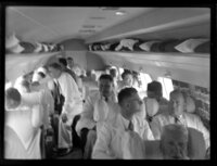 Hon Tupua Tamasese Mea'ole and other passengers on board aircraft, TEAL (Tasman Empire Airways Limited), Satapuala, Upolu, Samoa