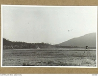 """TOWNSVILLE, AUSTRALIA. 1942-11. GAS SHELL BURSTING OVER """"GUINEA PIGS"""" DURING THE DEMONSTRATION GAS SHELL SHOOT BY 5TH FIELD REGIMENT, ROYAL AUSTRALIAN ARTILLERY"""