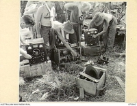 ALEXISHAFEN AREA, NEW GUINEA. 1944-04-27. TROOPS OF THE 8TH INFANTRY BRIGADE EXAMINE ABANDONED JAPANESE WIRELESS EQUIPMENT