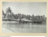 LABU, NEW GUINEA. 1944-10-03. A GENERAL VIEW OF THE CAMP OF THE 1ST WATERCRAFT WORKSHOPS. MANY VESSELS ARE TIED UP AT THE WHARF FOR REPAIRS