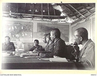 CAPE WOM, NEW GUINEA, 1945-09-13. SCENE DURING CONFERENCE BETWEEN STAFF OFFICERS OF 6 DIVISION, HEADED BY LIEUTENANT-COLONEL J. BISHOP GENERAL STAFF OFFICER I, AND STAFF OFFICERS OF 18 JAPANESE ..