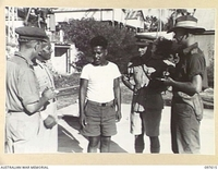 OCEAN ISLAND, 1945-10-01. WAR CORRESPONDENTS INTERVIEWING GILBERTESE ISLANDER NABETARI WHO LIVED AT SEA FOR 7 MONTHS IN ESCAPING FROM THE JAPANESE DURING THE OCCUPATION. MAJ R.F. WAKEFIELD, BRITISH ..