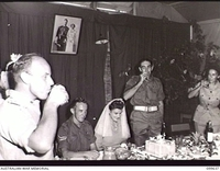 RABAUL, NEW BRITAIN, 1946-01-05. CAPTAIN M. A. STRATTON, OFFICER COMMANDING AUSTRALIAN MOVEMENT CONTROL, PROPOSING THE TOAST TO CORPORAL R. STANLEY, AUSTRALIAN MOVEMENT CONTROL, AND HIS BRIDE, ..