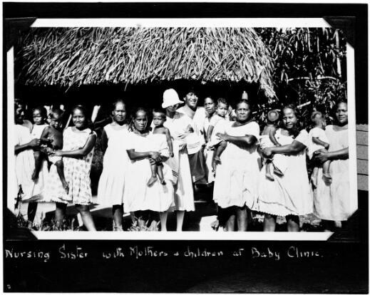Nursing sister with mothers and children at a baby clinic, Nauru, approximately 1930s