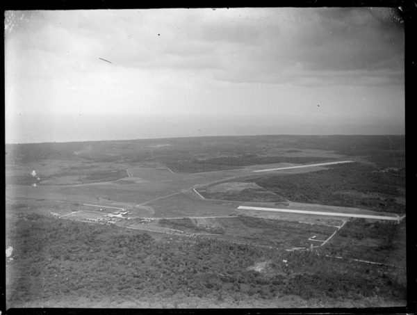 Aerial view of Fua'Amotu Airfield with runways surrounded by bush, Tonga
