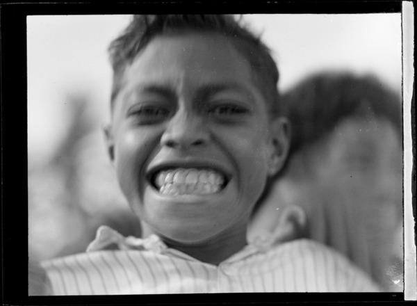 A close-up portrait of a local Tongan boy, Tonga