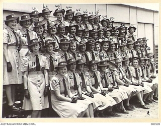 Group portrait of the members of the Women's Land Army at the Atherton Barracks. There are over 50 women at the barracks who work a 5 day week within a 12 mile radius of Atherton. Identified, left ..