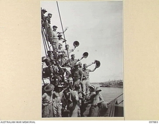 OFF BORAM BEACH, NEW GUINEA. 1945-10-13. THE FIRST BATCH OF TROOPS TO LEAVE THE WEWAK AREA UNDER THE PRIORITY DEMOBILISATION SCHEME WERE MEMBERS OF 6 DIVISION. SHOWN, TROOPS ALREADY EMBARKED ON ..