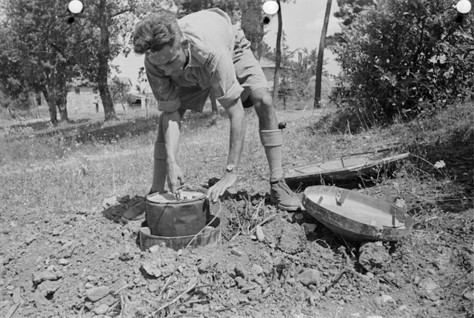 Sound ranging equipment being used by a New Zealand soldier to locate enemy guns, Florence area, Italy - Photograph taken by George Kaye