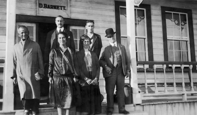 Group, including Sir Apirana Ngata, Whina Cooper and George Forbes, on the steps of the Opononi Hotel