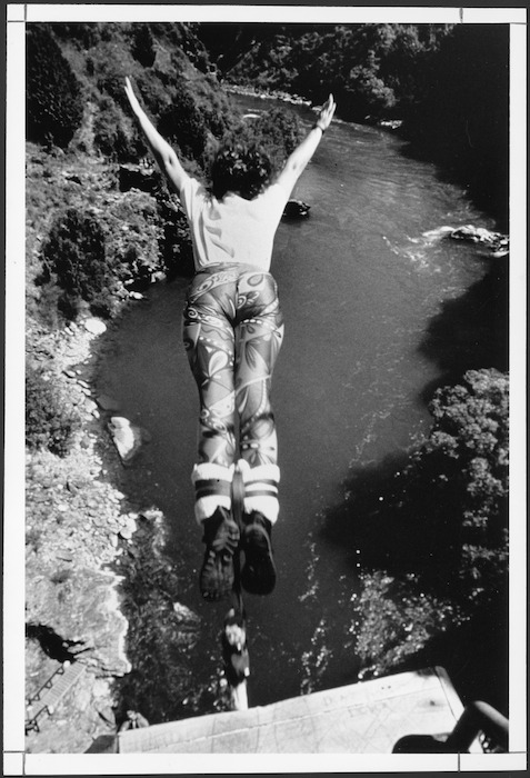 Woman doing a A J Hackett bungy jump at Skippers Canyon, Otago