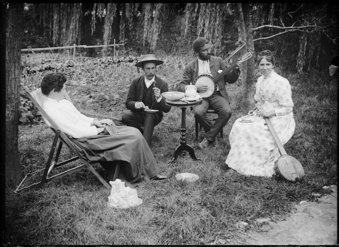Lydia and William Williams seated in a garden with two others