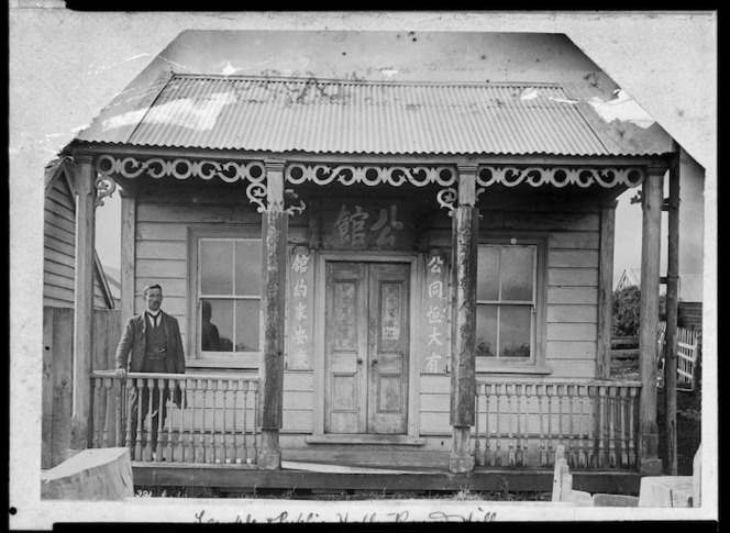 Reverend George Hunter McNeur outside the Chinese temple at Round Hill, Otago
