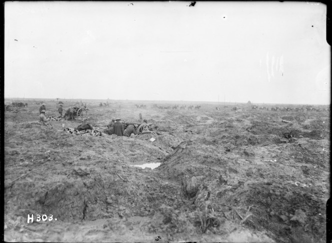 New Zealand artillery firing from shell-holes, Kansas Farm, Ypres Salient