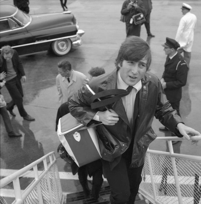 Beatle John Lennon boarding aircraft after visit to Wellington