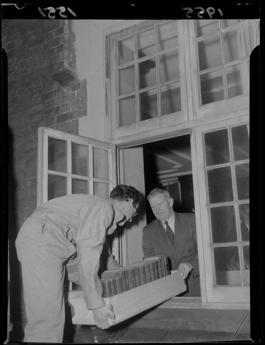 Staff of the Alexander Turnbull Library moving the book collection out of the Bowen Street building for the restrengthening in 1955-1957