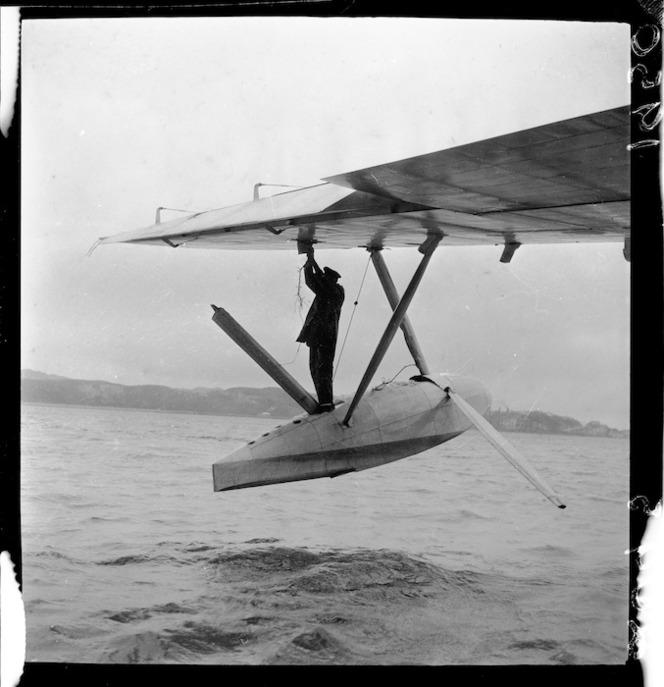 Working on the damaged float of TEAL Solent flying boat Ararangi, Evans Bay
