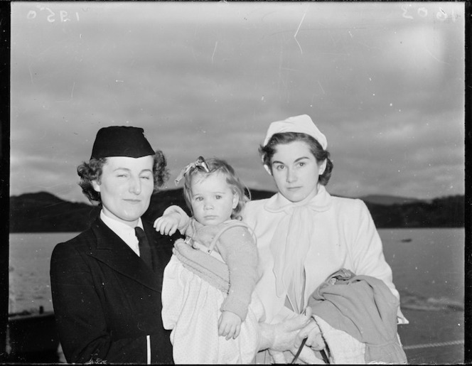 Stewardess with passengers from the first TEAL Solent flying boat flight from Sydney to Wellington