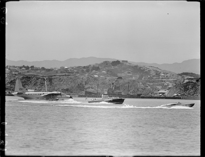 The speedboat Redhead and the flying boat Ararangi at Evans Bay, Wellington