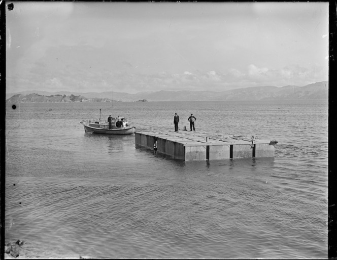 Section of the flying boat pontoon being towed by pilot boat Tuna from Seaview to Evans Bay, Wellington