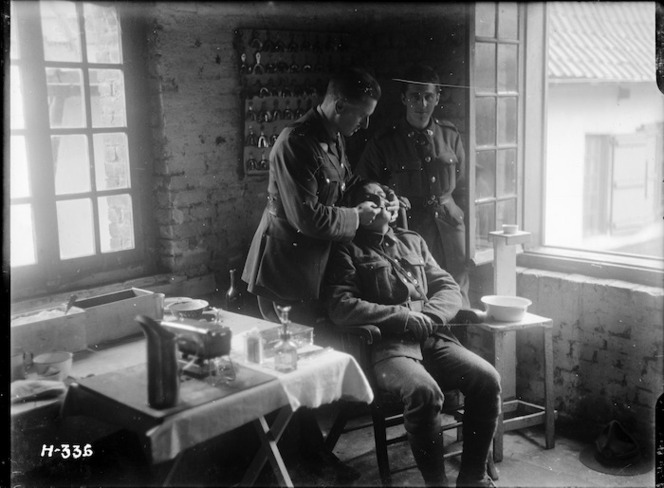 Soldier having new dentures fitted during World War I. Nielles, France. Royal New Zealand Returned and Services' Association: New Zealand official negatives, World War 1914-1918\. Ref: 1/2-012973-G