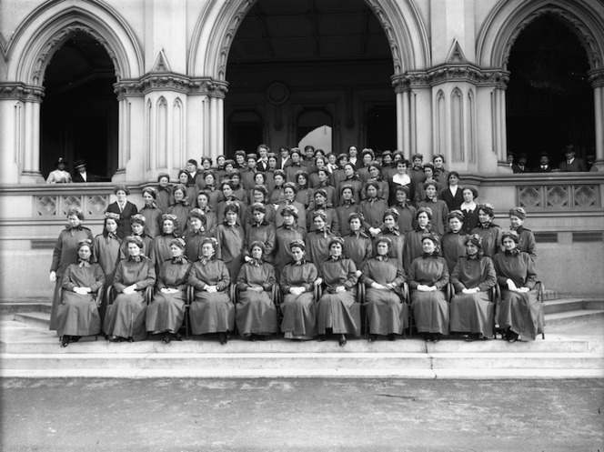 Group portrait of the first nurses to leave for World War I. The steps of the General Assembly Library, Wellington, New Zealand. The Press (Newspaper): Negatives. Ref: 1/1-008879-G