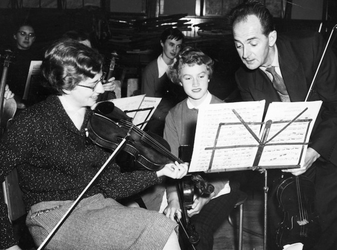 Violinists Olwen Castle and Silvia Roberts, under the direction of Vincent Aspey