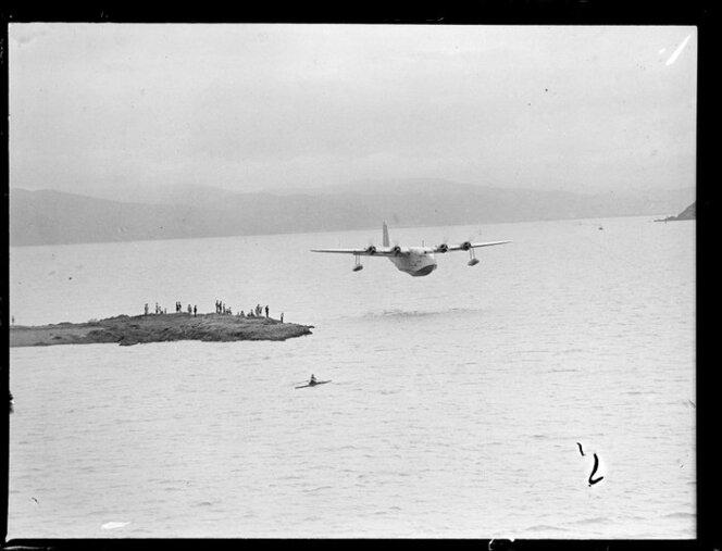 Flying boat, Centaurus, flying low over Wellington Harbour