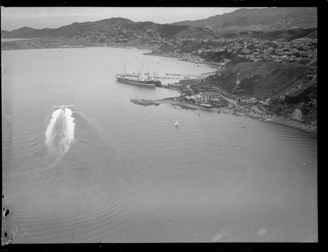 Flying boat, Centaurus, taxiing past the Miramar Wharf, Wellington Harbour