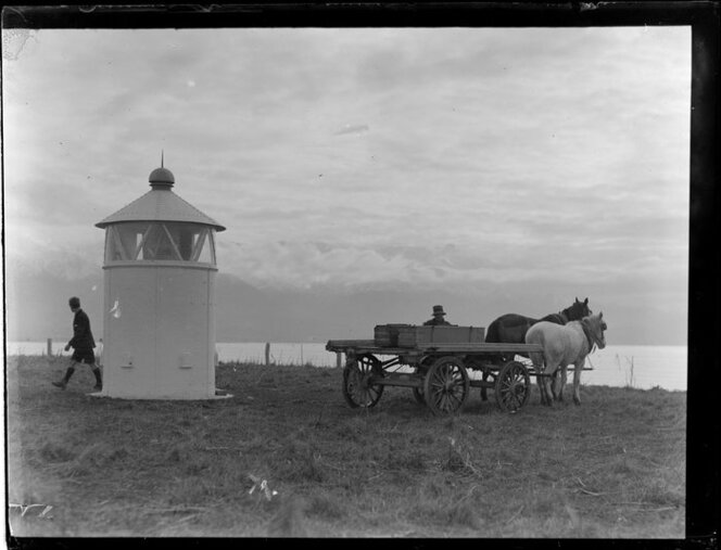 Kaikoura lighthouse with two unidentified men and a cart and horses beside it. Ref: WA-25032-G.