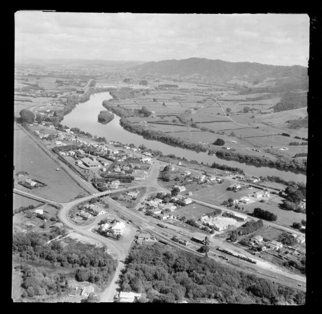 Taupiri, Waikato, view of township on the banks of the Waikato River looking south, Great South Road (State Highway 1) and railway station with Te Puru Street and Greenlane Road and Te Putu Street, with farmland beyond