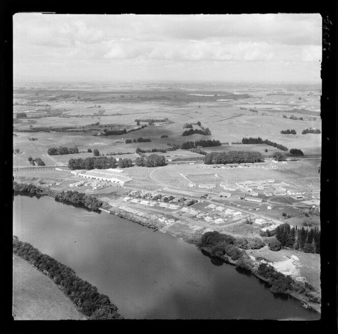 Ngaruawahia, Waikato, view of Hopuhopu Military Camp on the banks of the Waikato River with training grounds, barracks, residential housing and rugby field, farmland beyond